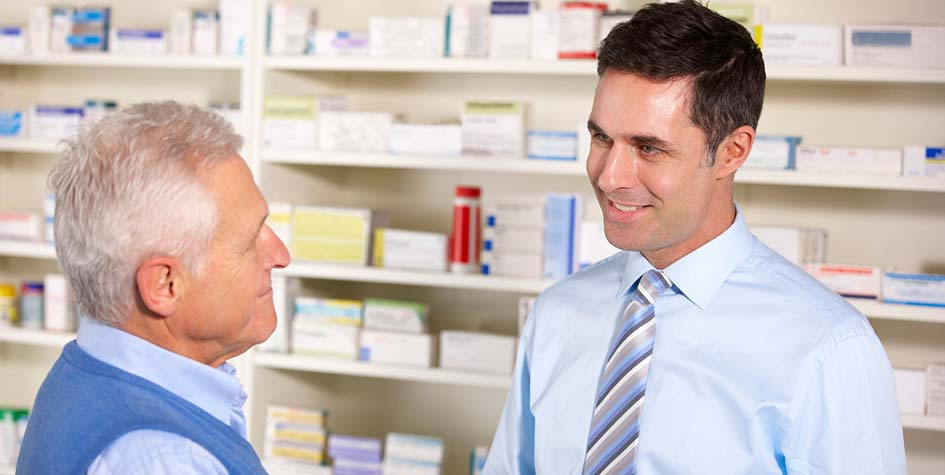Senior man with pharmacist